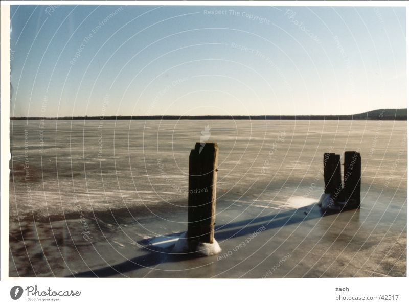 frozen lake Colour photo Exterior shot Deserted Copy Space left Copy Space top Evening Twilight Shadow Long shot Vacation & Travel Winter Water Cloudless sky