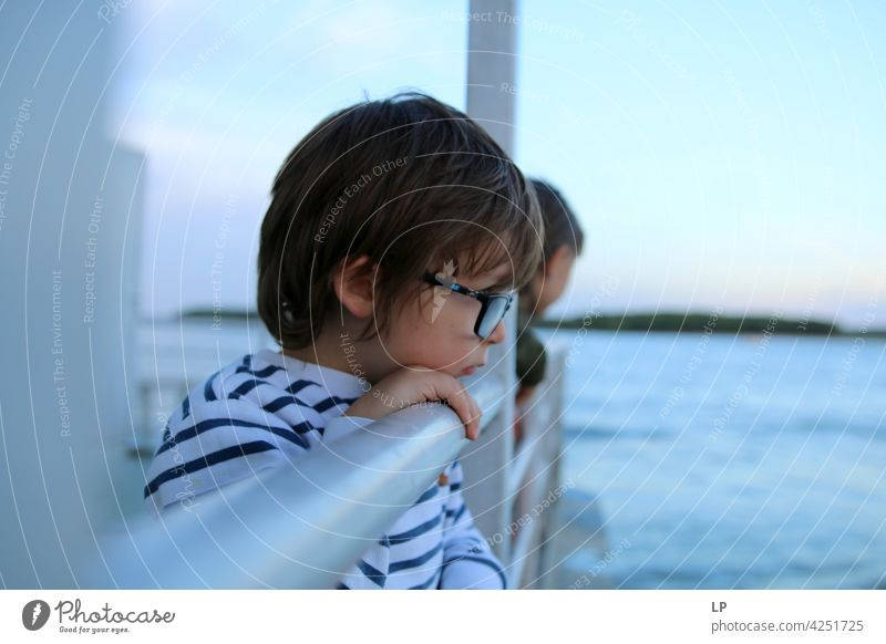portrait of a child wearing  glasses and looking at the water difficulties empathy challenge Complex need soothing Behavior coping with social distancing
