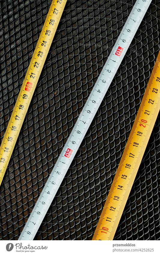 Steel tape measure. Measuring tool on metal surface. Technical background hardware iron steel use useful workshop improvement repair group service fix
