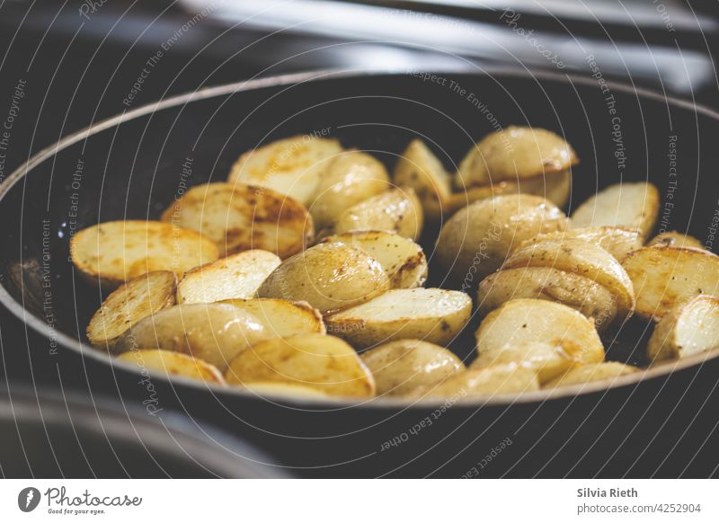 Potatoes with skin are fried in a pan roast potatoes Delicious Food Nutrition Organic produce Lunch Eating Vegetarian diet Healthy Eating Colour photo