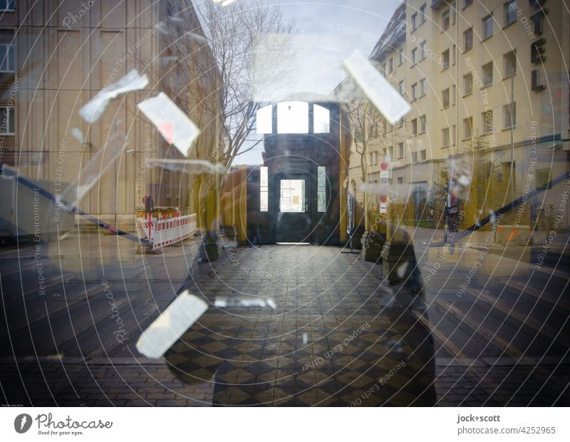 photograph through a reflecting glass pane Passage Silhouette Reflection Pane Window pane Downtown Berlin adhesive tape house facade Tile Sky bare tree