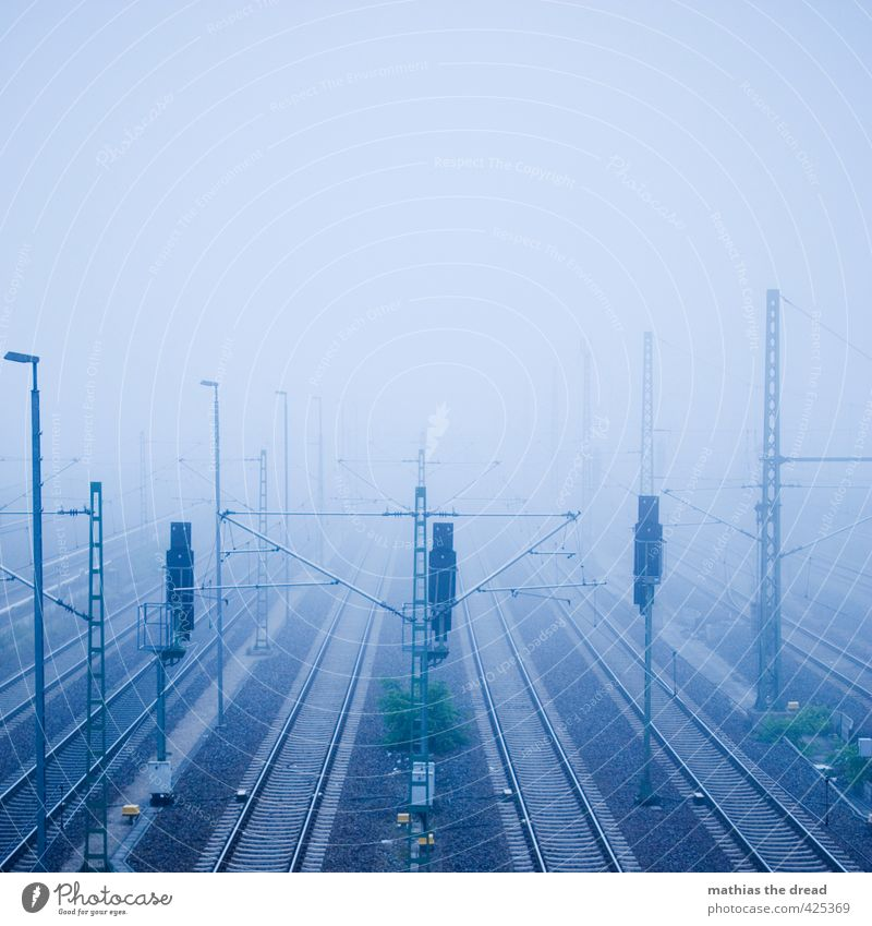 Sky Blue Clouds Dark Cold Line Fog Gloomy Logistics Railroad tracks Traffic infrastructure Haze Means of transport Train travel Rail transport Signal station