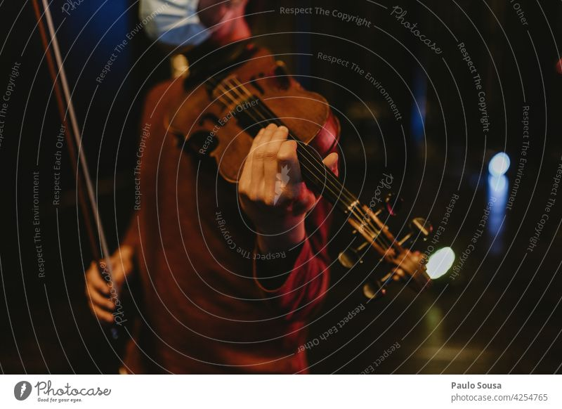Man with face mask holding violin Violin Violinist Music Musician instrument Classical Colour photo bow Art Concert Listen to music Close-up Make music Sound