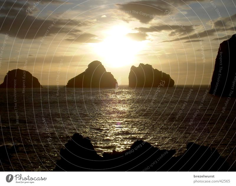 Water Sky Ocean Far-off places Mountain Coast Rock Kitsch Vestmannaeyjar Islands