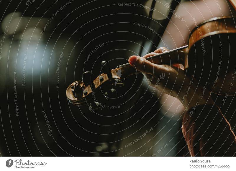 Close up hand holding violin Violin Violinist Orchestra Music Musical instrument String instrument Stage Wood Interior shot Listen to music