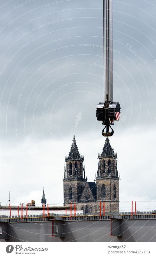 Taking the Magdeburg Cathedral on the Hook Dome Cathedral Towers Checkmark crane hook hock attach Colour photo Tourist Attraction Exterior shot Landmark