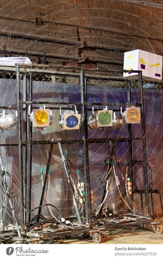 backstage behind-the-scenes old lamps and soffits in twilight lighting theatre music theater system mechanical art background vintage entertainment performance