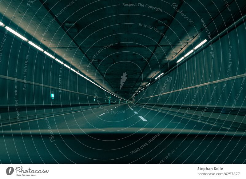 Driving through an empty underground tunnel in the teal and orange film look. car vehicle transport transportation drive road automobile background city urban