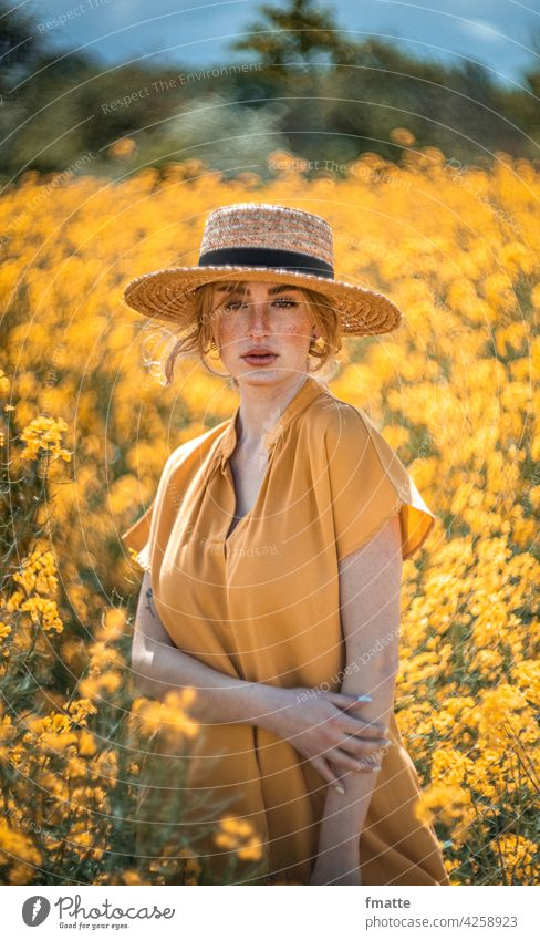 Woman with straw hat in rape field Straw hat Canola Canola field Oilseed rape flower Yellow Summer Freckles beauty in nature Beauty & Beauty Nature Plant
