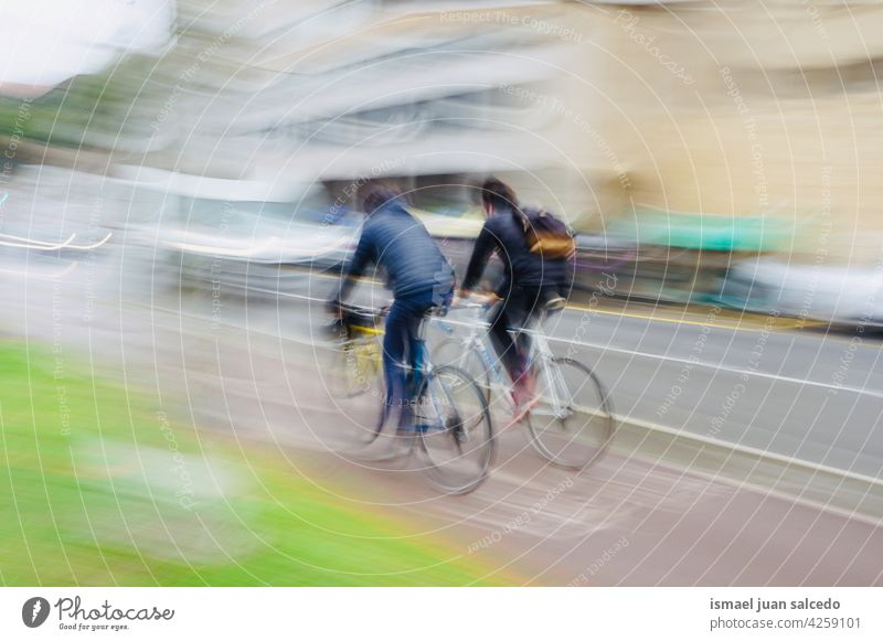 cyclist on the street in Bilbao city Spain biker bicycle transportation cycling biking exercise ride speed fast blur blurred motion movement defocused road