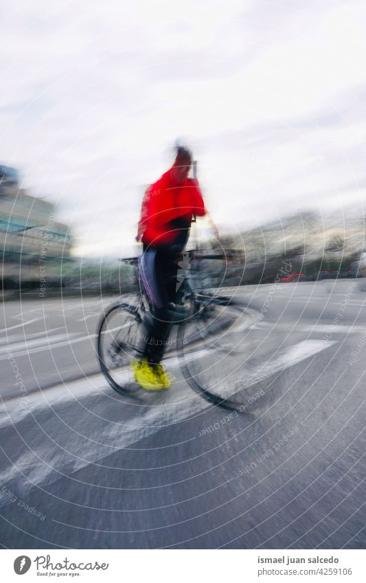 cyclist on the street in Bilbao city spain biker bicycle transportation cycling biking exercise lifestyle ride speed fast road urban outdoors people bilbao Blur