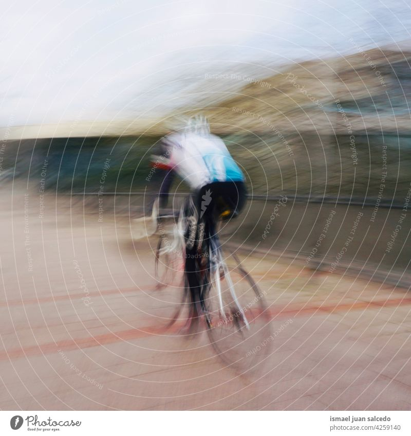 cyclist on the street in Bilbao city spain biker bicycle transportation cycling biking exercise lifestyle ride speed fast blur blurred motion movement defocused