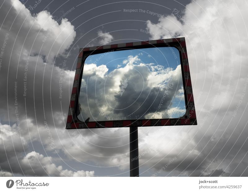 Sky, clouds around and in a traffic mirror Reflection traffic mirrors Abstract Safety Far-off places Convex Design Moody Road safety Mirror