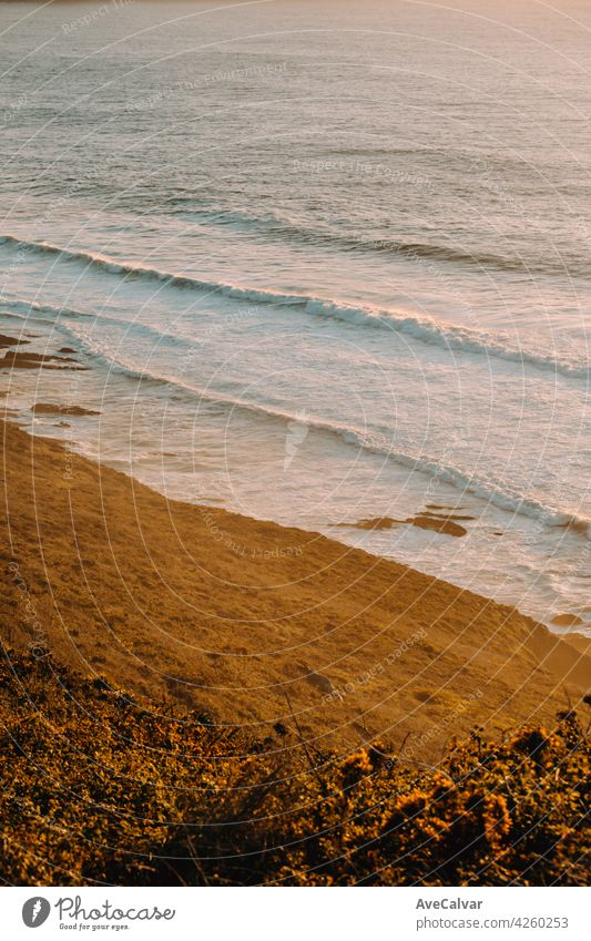 Aerial shot of a massive beach with waves during a super sunny sunset on vintage tones evening dusk horizon sunrise twilight clear do golden high scene tranquil