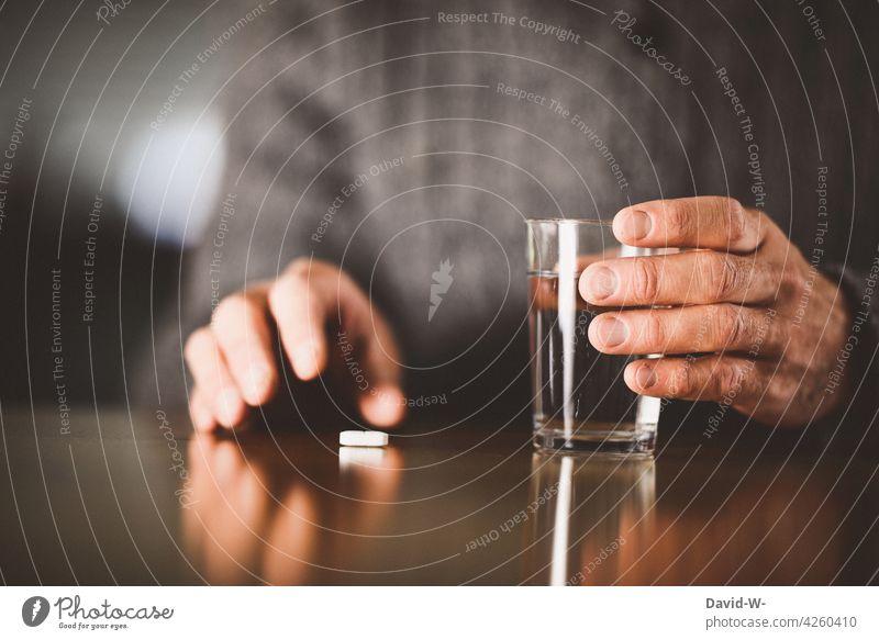 Man takes medication drugs Pill Illness Sick Medication Medical treatment Health care Hand Earn Healthy medicine