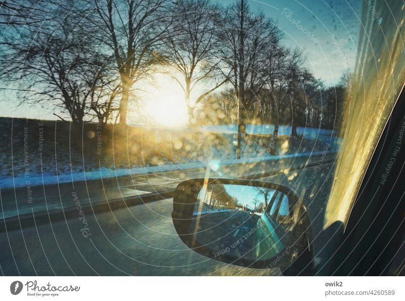 pause view outside Rear view mirror Road traffic Street Mysterious Detail Blur in the background In transit Pane Window pane Car Transport Colour photo