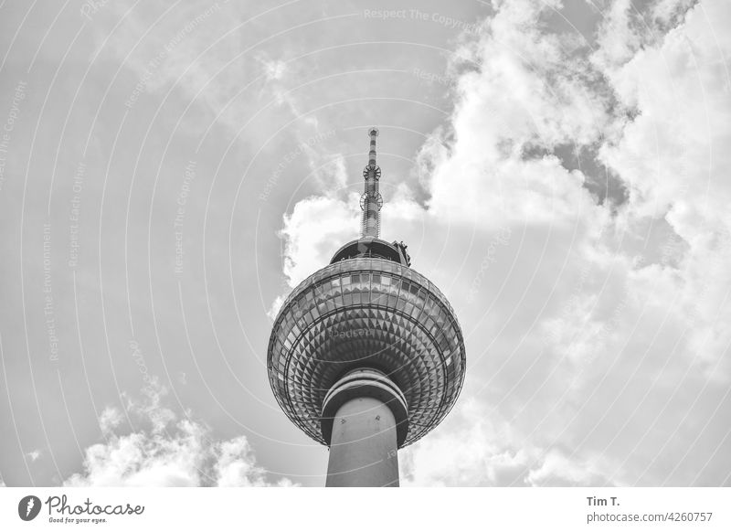 the television tower from below Television tower Berlin Middle b/w Sky Clouds Capital city Downtown Town Exterior shot Architecture Deserted Manmade structures