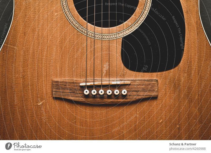 Western guitar in the cut Guitar Music Make music tool Musical instrument Wood Wood grain Veneer Wooden ceiling Guitar strings Acoustic Sound