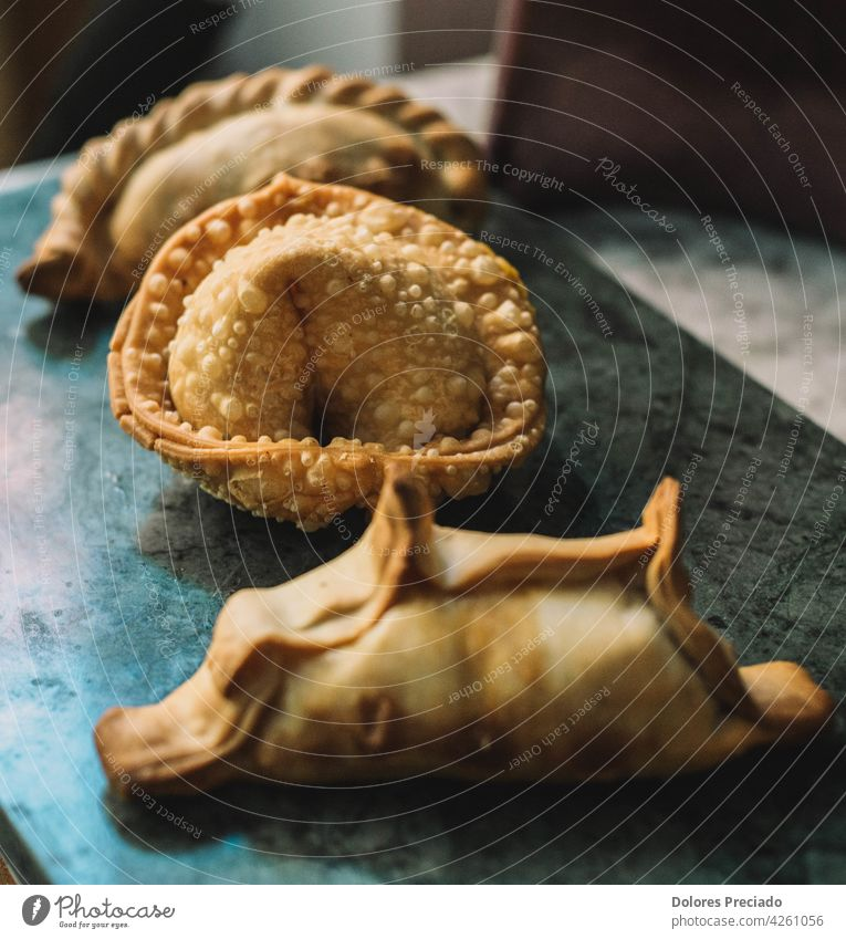 Assorted stuffed empanadas typical of South America pastel homemade lunch antipasto chicken appetizer ethnic latin cooked hispanic table pastry cooking