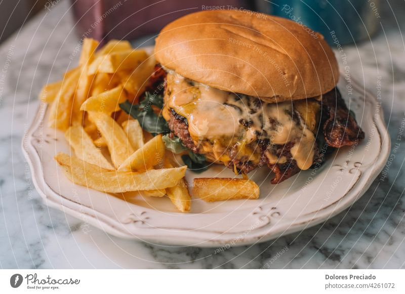 Beef cheese burger with fries ketchup isolated board table Cholesterol mayonnaise sauce arugula comfort food copy space double dinner delicious cuisine fresh