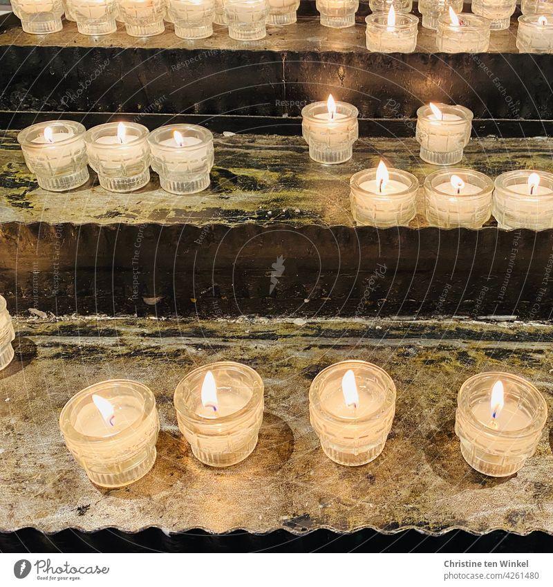 Sacrificial candles ... Sacrificial Lights Belief Hope Candlelight shoulder stand Prayer Grief religion burning candles Remember Calm Chapel pray Spirituality