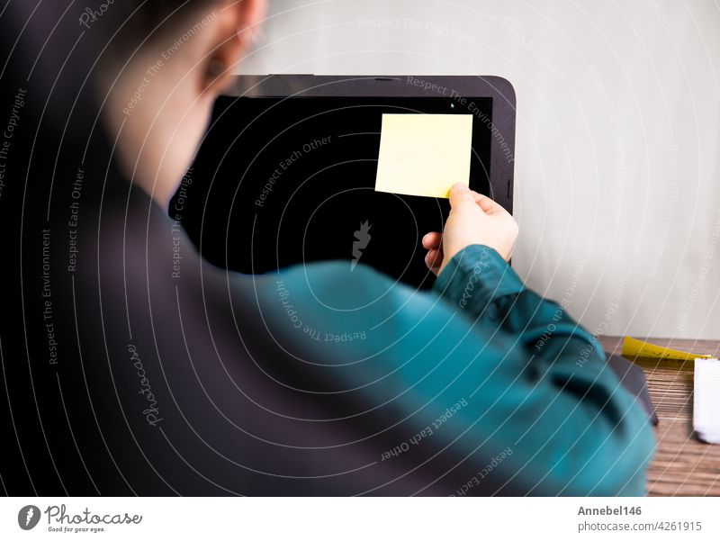 Business woman work from home with blank sticky post on computer for reminder business, home office closeup copy space modern design background family hand