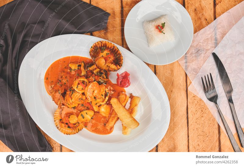 Peruvian culinary fried fish A lo Macho style with seafood sauce peru restaurant meal peruvian cuisine rice lemon gastronomy exotic cooking cebiche shrimp