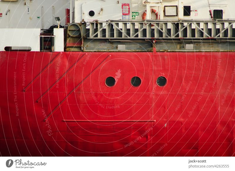Red ship wall with three portholes from fat freighter ship's side Detail Background picture Structures and shapes Authentic Ship's side Steel Porthole Maritime