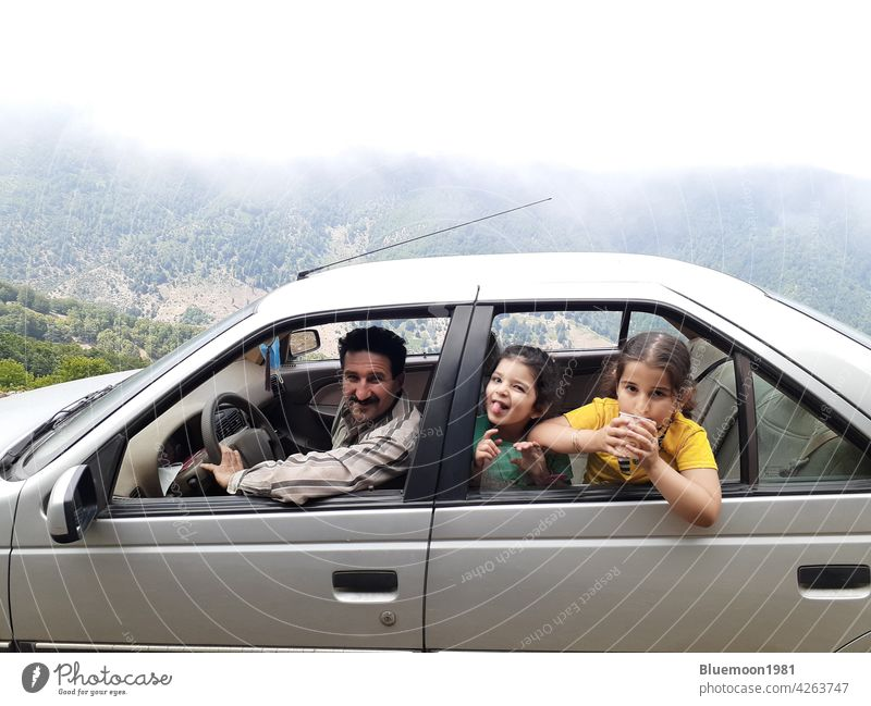 Family at car-travel concept adult auto automobile back beautiful drinking drive driver family fun girl gray group of people happiness happy holiday lifestyle