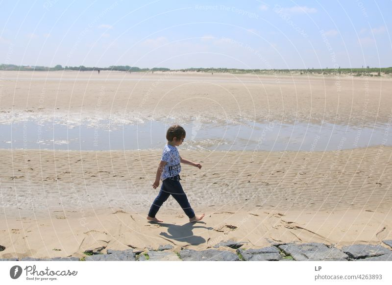 boy walking on the beach lonely Think Infancy Concern solitude pensive people abuse Expression Pain Fatigue Abstract Human being Exterior shot Education