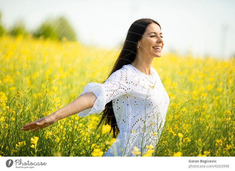 Young woman in the rapeseed field beautiful outside yellow summer outdoor beauty happy spring person meadow nature flower freedom female lifestyle sunny floral
