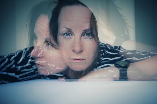 Double exposure Concern portrait Striped sweater Looking into the camera Forward Worry line Earnest Loneliness Human being Adults Face disorientation Woman