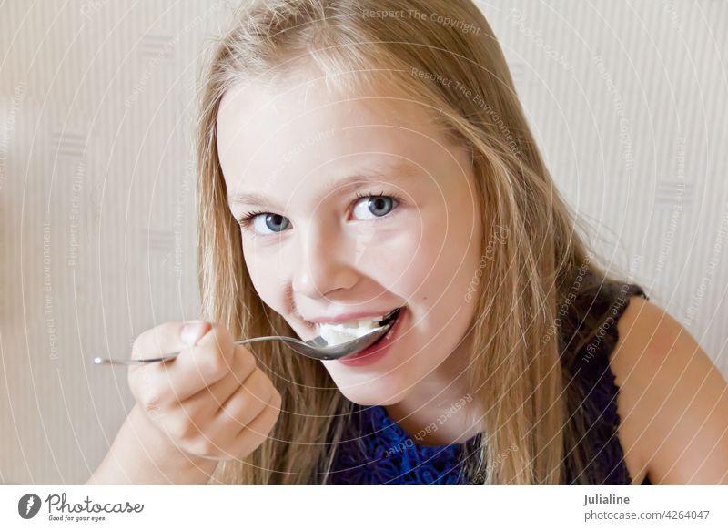 Eating cute girl child kid eating preschooler schoolgirl six seven blue blond white childhood Caucasian european eight portrait