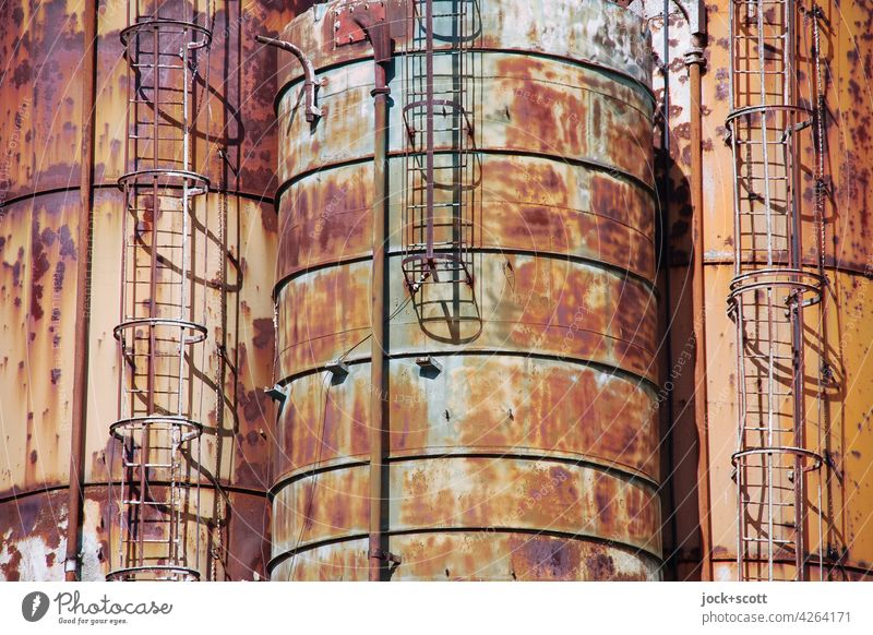 Oxidation causes complete corrosion damage x three Tank corroded russet Metal conductor Destruction Side by side Apocalyptic sentiment Decline Transience