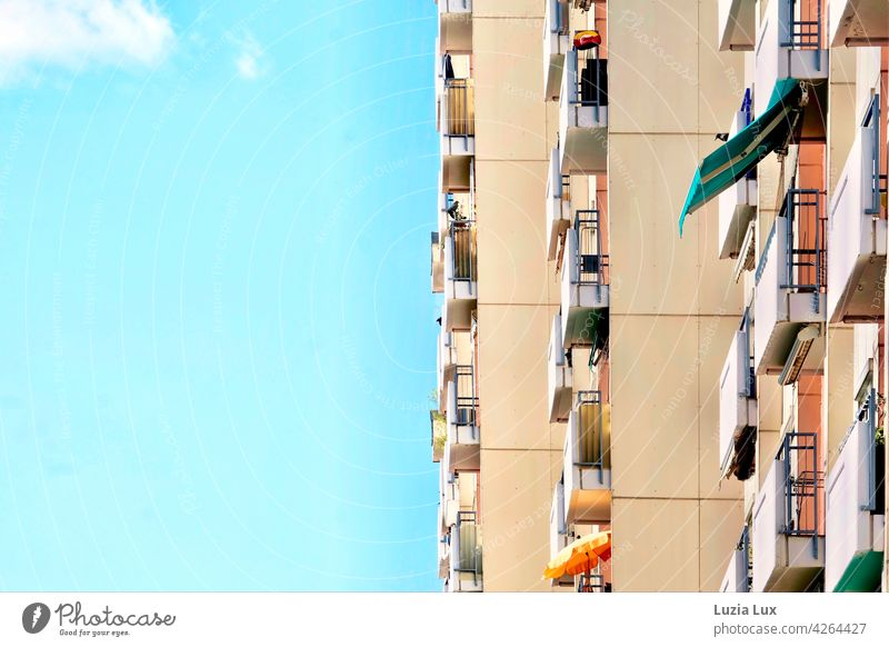 Vertical in spring: balconies lined up on a high-rise building High-rise Facade Architecture Building Town Sky Day Spring Sun Clouds sunshine Sunshade Direct