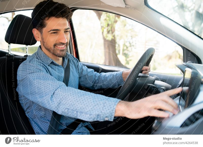 Man using gps navigation system in car. man drive technology device travel transport vehicle urban business connection panel app businessman search male