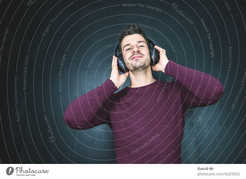 Music makes a good mood - man listens to music with his headphones Listening Good mood Headphones Man happy Happiness Contentment Smiling Bluetooth headphones