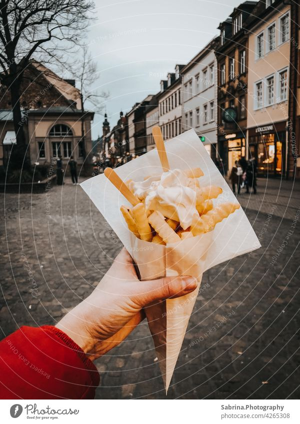 A portion of French fries with mayonnaise in the left hand on Hauptstraße, Heidelberg Mayonnaise Eating Fast food Food Fat Baden-Wuerttemberg Germany