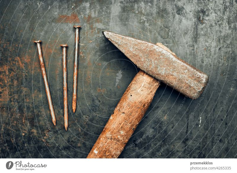 Hammer and nails on steel surface. Tools for maintenance. Hardware tools to fix. Technical background metal hardware iron old used heavy useful workshop