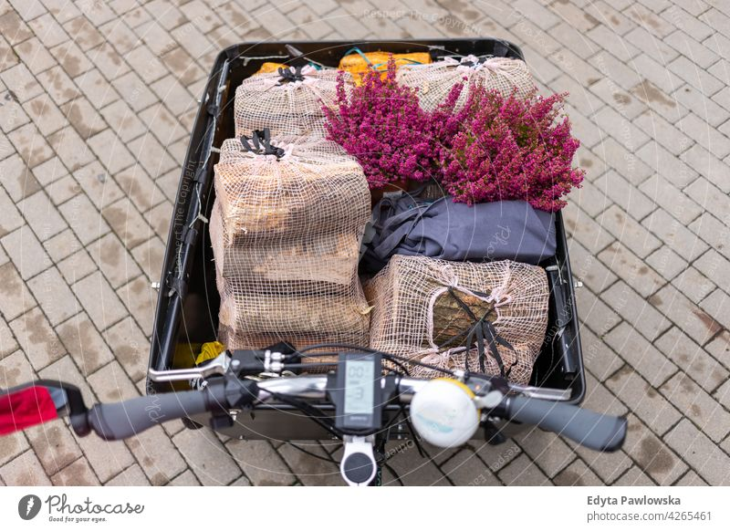 Shopping in a cargo bike shopping carrying tricycle day healthy lifestyle active outdoors joy bicycle biking activity cyclist enjoying bike ride modern