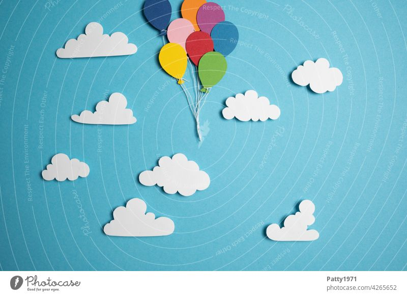 Balloons cut out of paper float between fluffy clouds through the sky out of the picture. Many Sky Clouds Hover Go up Low-cut forsake sb./sth. Flying in common