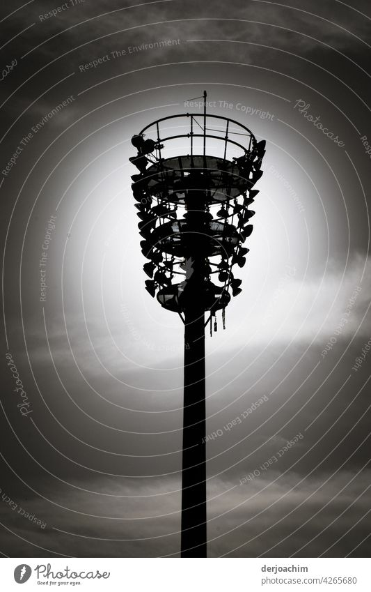 A light pole with many small lamps, in the dark evening sky. Pole Sky Deserted Exterior shot Day B/W Black & white photo Clouds Analog Environment Lamp