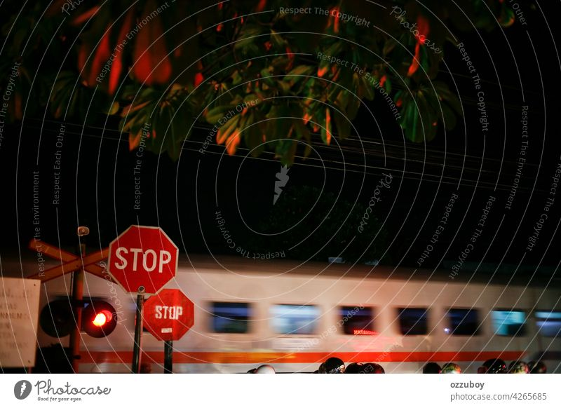 railroad crossing with passing train at night with Motion Blur Effect crossing sign light transportation speed motion traffic danger track railway red street