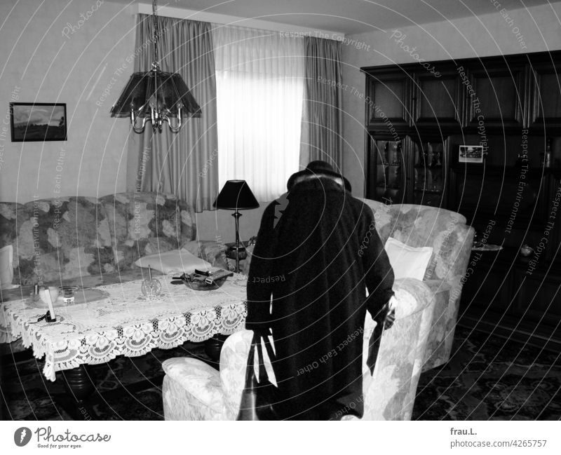 Nobody there? at home House (Residential Structure) Home country Degersen on one's own Woman Hat Montage Coat Newspaper Handbags Living room Old Crooked Table