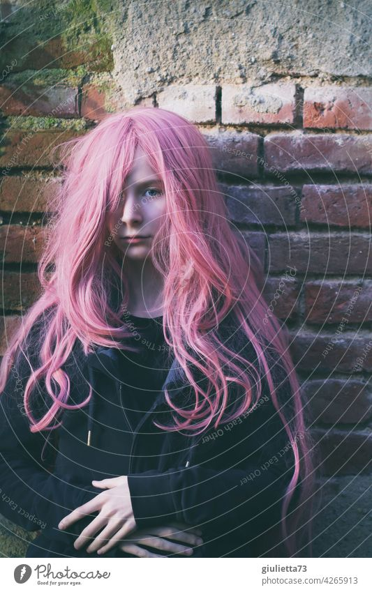 Portrait of a teenage girl with long pink hair Rebellious differently Invisible Mistrust Doubt Half-profile Inspiration Dream Meditative Life Punk Crazy Pink