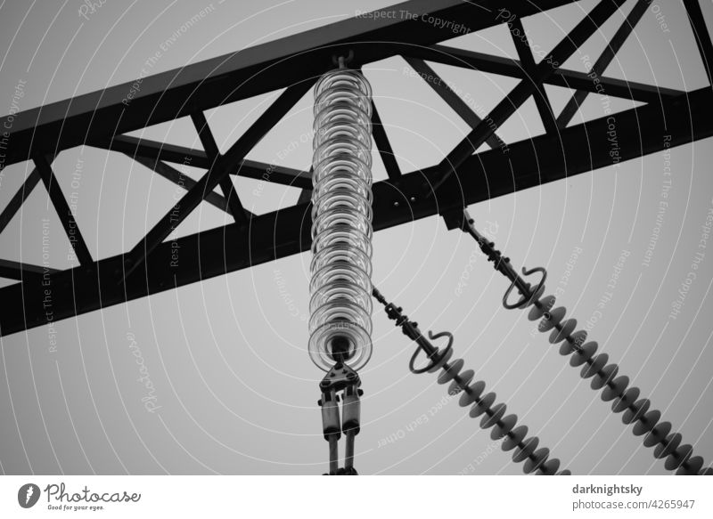 Insulators made of glass on a high voltage overhead line in detail Renewable energy Technology Energy crisis Power transmission diagonal intersecting Industry