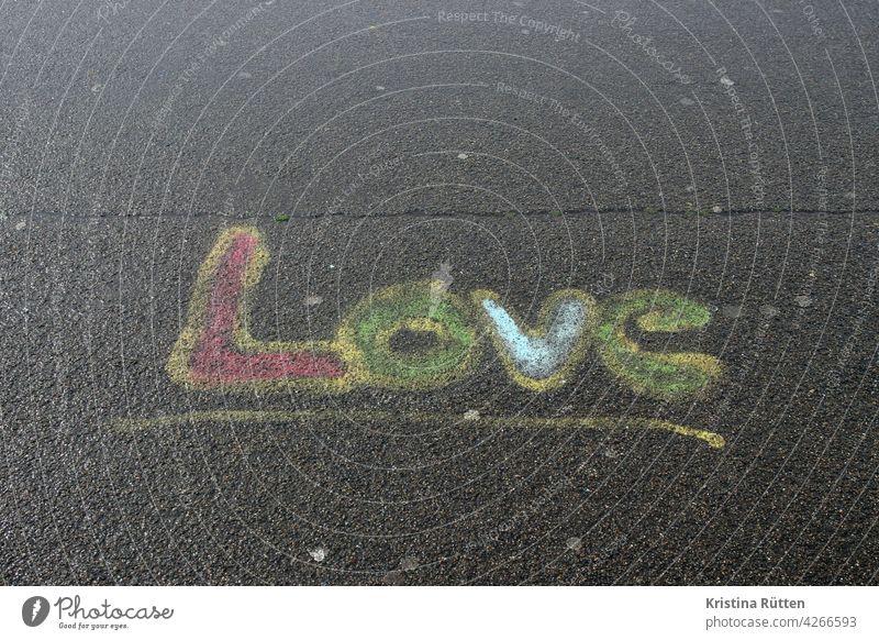 love - painted on the asphalt Love In love sensation Street painting Asphalt off Ground Painted Chalk variegated Declaration of love Affection relation