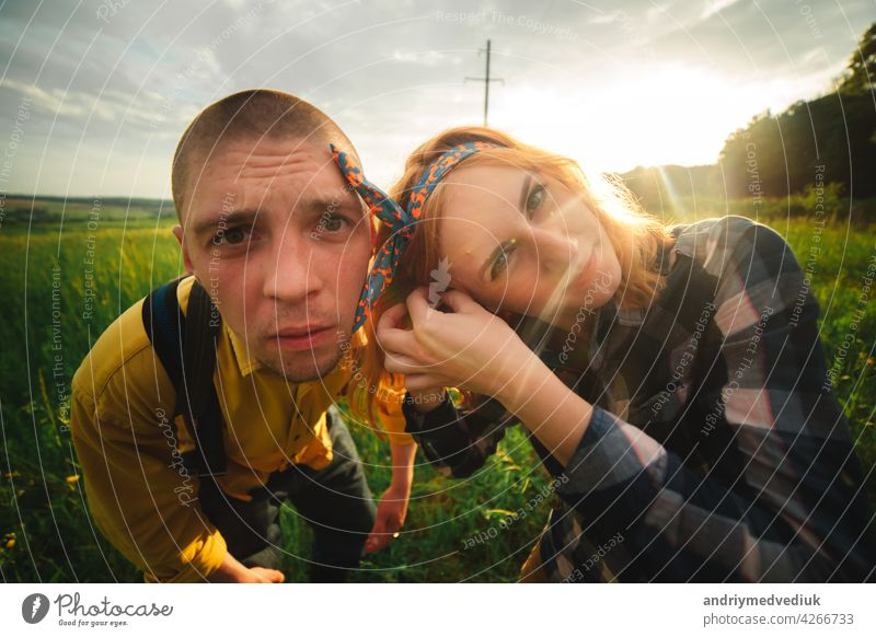 Playful happy handsome couple having while walking in woods. tourists in the mountains. Adventure in nature concept. lifestyle love playful piggyback outdoors