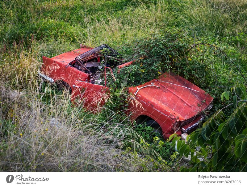 Abandoned wrecked car, Malaga province, Andalusia, Spain red grass accident vintage green Frigiliana Nerja Malaga Province old auto vehicle automobile