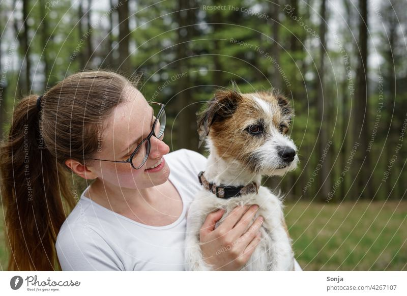 Young smiling woman with a small dog on her arm Woman Smiling youthful Dog Small Terrier Pet Animal Cute Happy portrait pretty Lifestyle Friendship